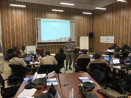 The director of the Defense Institute of International Legal Studies, Air Force Col. Kirk Davies, provides instruction at the inaugural training course for national investigative officers for U.N. peacekeeping operations, aimed at holding peacekeepers accountable for abuses such as sexual misconduct and preventing further crimes, Entebbe, Uganda.