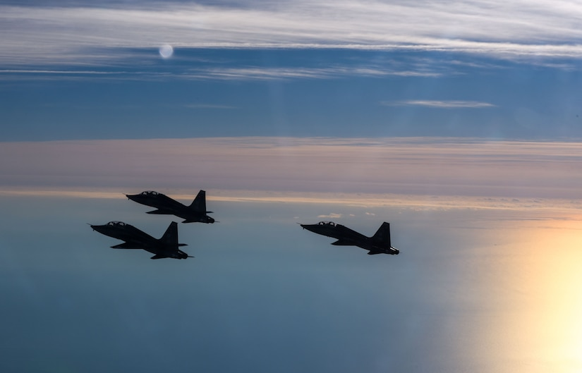 Pilots assigned to the 71st Fighter Training Squadron and the 192nd Fighter Wing fly T-38 Talons over the Atlantic Ocean, Jan. 24, 2018. The two-seat jet has a top speed of 858 miles per hour. As the world's first supersonic trainer, the T-38 first flew in 1959 and continues to be used to this day. (U.S. Air Force Photo by Staff Sgt. Carlin Leslie)