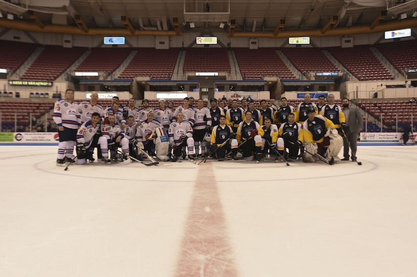 Members of the Charleston Patriots and Charleston Enforcers stand together during the Fourth Annual Deputy Joe Matuskovic Memorial Hockey Game at the North Charleston Coliseum, Jan. 27, 2018.