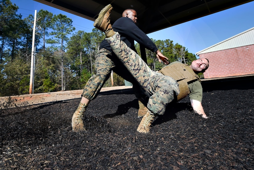 U.S. Marine Corps Staff Sgt. James Benson, left, and Staff Sgt. Justin Golden, both of Detachment 3 Supply Company, Combat Logistics Battalion 451, practice martial arts techniques during a Marine Martial Arts Program demonstration Jan. 25, at the U.S. Marine Corps Reserve Training Center at Joint Base Charleston's Naval Weapons Station, S.C. The MCMAP is designed to increase a Marine's warfighting capability and self-confidence and is based off the principle that every Marine is a rifleman. The MCMAP focuses on the physical, mental and character disciplines essential for a Marine to be successful in the program.
