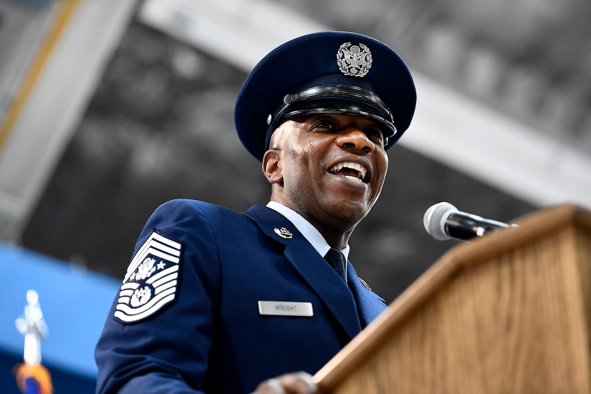 An Air Force leader stands behind a podium while giving remarks.