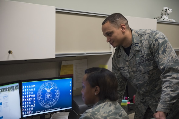 PETERSON AIR FORCE BASE, Colo. -- Capt. Marlon Peeler, 21st Medical Group TRICARE operations and patient administration flight chief, explains the TRICARE changes an Airman at Peterson Air Force Base, Colo., Jan. 12, 2018. A full list of TRICARE changes can be found at Tricare.mil/changes. (U.S. Air Force photo by Airman 1st Class Alexis Christian)