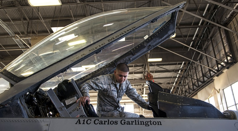 Senior Airman Eric Medina, 309th Aircraft Maintenance Unit dedicated crew chief, performs pre-flight inspections on an F-16 Fighting Falcon at Luke Air Force Base, Ariz., Jan. 25, 2018. DCCs are technical maintenance experts of their assigned aircraft and play a vital role in the success of Luke's mission. (U.S. Air Force photo/Airman 1st Class Alexander Cook)