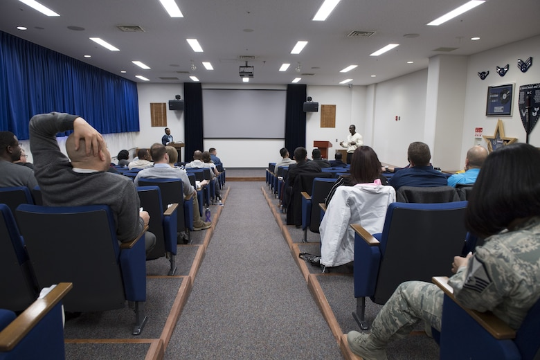Senior Master Sgt. Sherlock Walker, 374th Communications Squadron operations superintendent and Total Force Leadership Development Program lead, (left), and Senior Master Sgt. Gabriel Lewis, 5th Air Force superintendent and Total Force Leadership Development Program lead facilitator, direct a group discussion, Jan. 29, 2018, at Yokota Air Base, Japan.