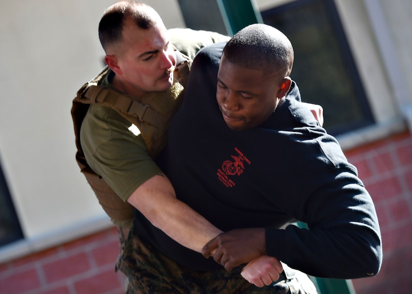 U.S. Marine Corps Staff Sgt. James Benson, right, and Staff Sgt. Justin Golden, both of Detachment 3 Supply Company, Combat Logistics Battalion 451, practice martial arts techniques during a Marine Martial Arts Program demonstration Jan. 25, at the U.S. Marine Corps Reserve Training Center at Joint Base Charleston's Naval Weapons Station, S.C. The MCMAP is designed to increase a Marine's warfighting capability and self-confidence and is based off the principle that every Marine is a rifleman. The MCMAP focuses on the physical, mental and character disciplines essential for a Marine to be successful in the program.