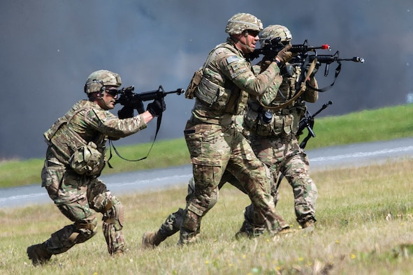 Paratroopers assigned to the 6th Brigade Engineer Battalion (Airborne), 4th Infantry Brigade Combat Team (Airborne), 25th Infantry Division, U.S. Army Alaska, bound toward their objective as part of the Joint Forces Demonstration during the Arctic Thunder Open House, July 1, 2018. This biennial event hosted by Joint Base Elmendorf-Richardson, Alaska, is one of the largest in the state and one of the premier aerial demonstrations in the world. The event features multiple performers and ground acts to include the JBER joint forces, U.S. Air Force F-22, and U.S. Air Force Thunderbirds demonstrations teams, June 30-July 1.