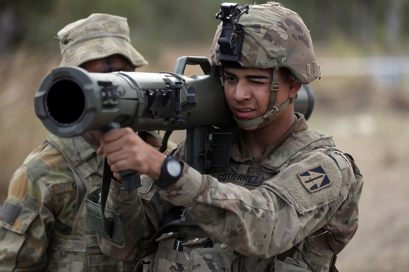 A soldier aims a recoilless rifle.