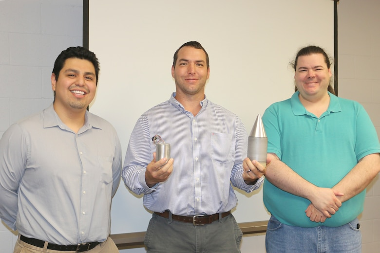 Elvis Encalada, Jesse Labello and David Woods, engineers with the Space and Missiles Combined Test Force at Arnold Air Force Base, have worked together to develop a telemetry package that will be used to transmit data when launching projectiles. According to the team, the use of this telemetry package will enable AEDC test customers to obtain critical data about boundary layer transition during hypersonic flight and hypervelocity impacts. (U.S. Air Force photo/Deidre Ortiz)