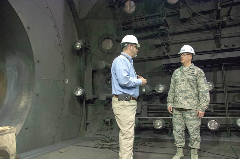 Jason Austin, director of AEDC Public Affairs, gives Chief Master Sgt. Robert Heckman, AEDC Superintendent, a tour of the test facilities at Arnold Air Force Base. Heckman recently started in his new role at Arnold, previously serving as superintendent of the 460th Operations Group, headquartered at Buckley AFB, Colorado. As AEDC Superintendent, Heckman will be an advisor to AEDC Commander Col. Scott Cain on all issues regarding operations, readiness, morale, good order and discipline at the Complex. (U.S. Air Force photo/Christopher Warner)