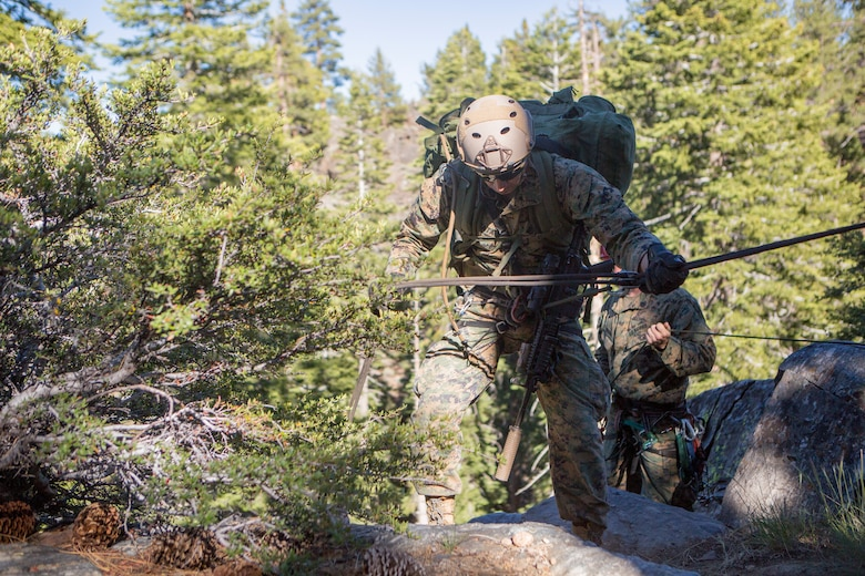 A reconnaissance Marine with 4th Reconnaissance Battalion, 4th Marine Division, rappels down a cliff side during Mountain Exercise 3-18, at Mountain Warfare Training Center, Bridgeport, Calif., June 20, 2018. After completing Integrated Training Exercise 4-17 last year, 4th Reconnaissance Battalion took part in MTX 3-18 to further develop small-unit leadership and build an understanding of the different climates and scenarios they could face in the future.