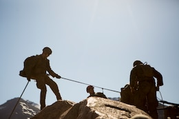 Marines with 2nd Battalion, 24th Marine Regiment, 23rd Marines, 4th Marine Division, begin their preparations of rappelling down a cliffside, during Mountain Exercise 3-18, at Mountain Warfare Training Center, Bridgeport, Calif., June 22, 2018. After completing Integrated Training Exercise 4-17 last year, 2nd Bn., 24th Marines took part in MTX 3-18 to further develop small-unit leadership and build an understanding of the different climates and scenarios they could face in the future.