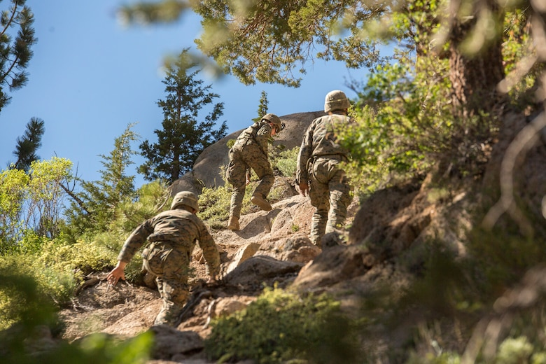 Marines with 2nd Battalion, 24th Marine Regiment, 23rd Marines, 4th Marine Division, hike up to a rally point to rappel down a cliffside, during Mountain Exercise 3-18, at Mountain Warfare Training Center, Bridgeport, Calif., June 22, 2018. After completing Integrated Training Exercise 4-17 last year, 2nd Bn., 24th Marines took part in MTX 3-18 to further develop small-unit leadership and build an understanding of the different climates and scenarios they could face in the future.