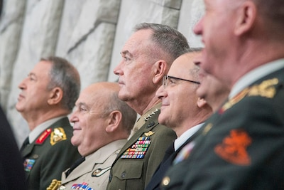 Marine Corps Gen. Joe Dunford, chairman of the Joint Chiefs of Staff, takes part in arrival ceremonies at the 179th Military Committee in Chiefs of Defense Session at the new NATO headquarters building in Brussels, May 16, 2018. DoD photo by Navy Petty Officer 1st Class Dominique A. Pineiro