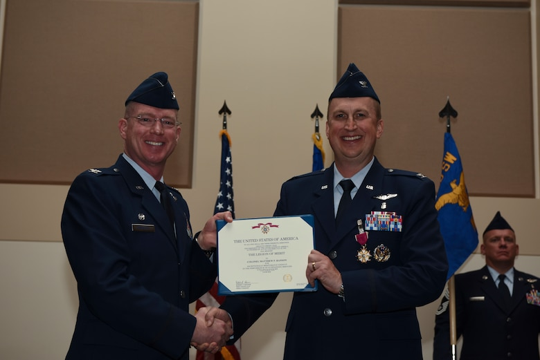 Col. Troy Endicott, 460th Space Wing commander, presents the Legion of Merit to Col. Matthew Hanson, 460th Medical Group commander, June 29, 2018, on Buckley Air Force Base, Colorado. Hanson will be attending U.S. Air Force Air War College after his departure from Buckley AFB. (U.S. Air Force photo by Airman 1st Class Michael D. Mathews)