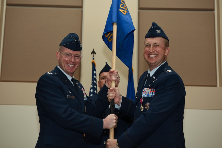 2-	Col. Troy Endicott, 460th Space Wing commander, receives the guidon from Col. Matthew Hanson, 460th Medical Group outgoing commander, June 29, 2018, on Buckley Air Force Base, Colorado. The exchanging of the guidon symbolizes the official change of command. (U.S. Air Force photo by Airman 1st Class Michael D. Mathews)