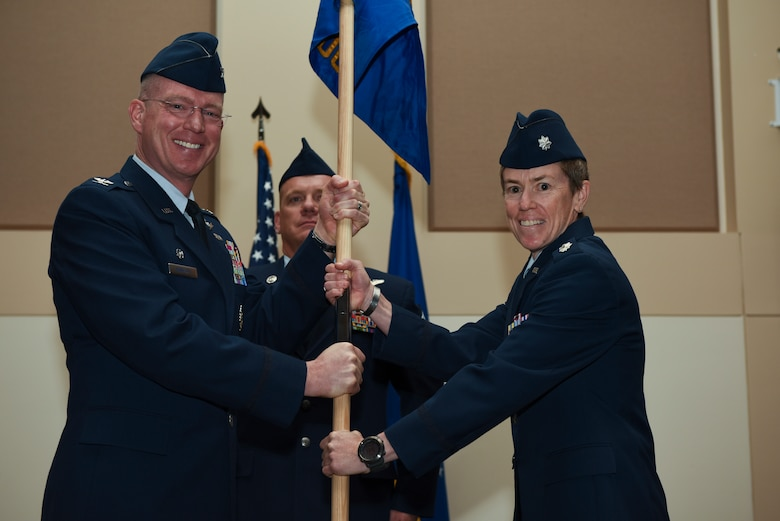 3-	Col. Troy Endicott, 460th Space Wing commander, passes the guidon to Lt. Col. Shannon Phares, 460th Medical Group commander, June 29, 2018, on Buckley Air Force Base, Colorado. The exchanging of the guidon symbolizes the official change of command. (U.S. Air Force photo by Airman 1st Class Michael D. Mathews)
