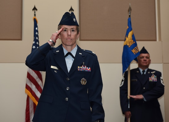 Lt. Col. Shannon Phares, 460th Medical Group commander, receives her first salute from the 460th MDG June 29, 2018, on Buckley Air Force Base, Colorado. Phares, who previously served as the Air Combat Command Aerospace Physiology Program Manager, assumed command from Col. Matthew Hanson. (U.S. Air Force photo by Airman 1st Class Michael D. Mathews)