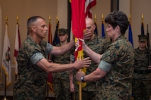 Maj. Gen. Loretta Reynolds, off-going commanding general, Marine Forces Cyberspace Command, passes the colors to on-coming commanding general, Maj. Gen. Matthew Glavy during a change of command ceremony at Fort George G. Meade, Maryland, July 2, 2018. During the ceremony, Reynolds was promoted to lieutenant general and will assume the duties of Deputy Commandant for Information, July 3, 2018.