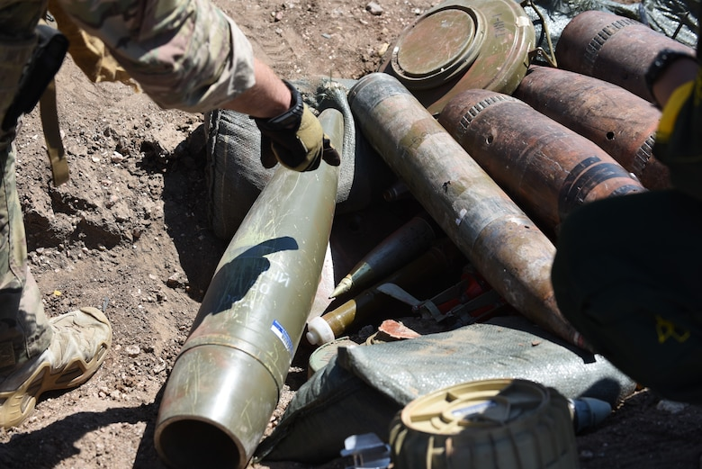 During a field training exercise by the 90th Civil Engineer Squadron Explosive Ordnance Disposal flight, the Airmen were able to get hands-on experience with unexploded ordinance found at home and over sea's locations June 27, 2018, at the EOD range, F.E. Warren Air Force Base, Wyo. The EOD team is continually updating their knowledge on weapons used by other militaries and implementing them into field training. (U.S. Air Force photo by Airman 1st Class Abbigayle Wagner)