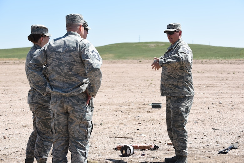 90th Civil Engineer Squadron leadership visit the Explosive Ordnance Disposal range to observe a portion of the three-day field training June 27, 2018, F.E. Warren Air Force Base, Wyo. The training encompassed various tools and techniques within the EOD career field and allowed the Airmen to experience simulated real-world scenarios. (U.S. Air Force photo by Airman 1st Class Abbigayle Wagner)