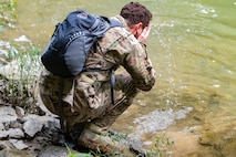 U.S. Air Force Maj. Joseph Shamess cools off in the Little Coal River while performing Survival, Evasion, Resistance and Escape (SERE) training June 2, 2018 at Alum Creek, W.Va.
