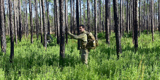 U.S. Staff Sgt. Jonathan Buchanan, 325th Operations Support Squadron non-commissioned officer in-charge of survival, evasion, resistance and escape (SERE) training, surveys a potential training area around Tyndall Air Force Base, Fla., for Tyndall's SERE program, Jan. 17, 2018.