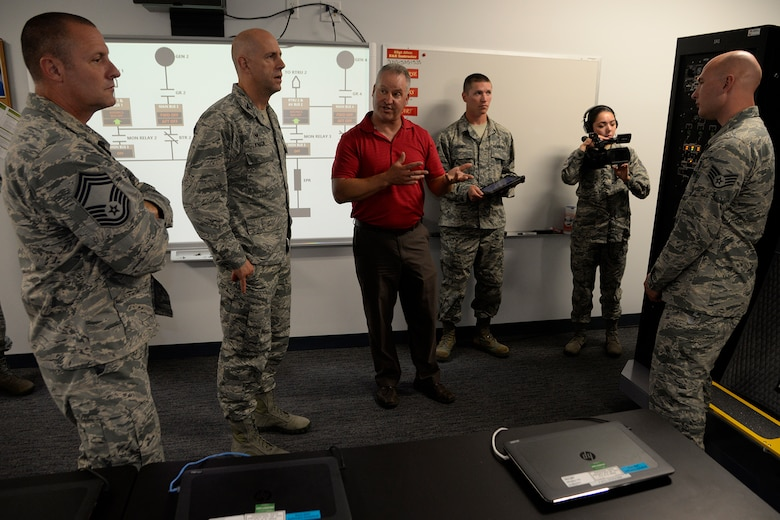 373rd Training Squadron Detachment 3 staff demonstrate the capabilities of the new C-5M Electrical Systems Trainer to Col. Tyler Knack, 436th Maintenance Group commander, and other members of maintenance leadership on Dover Air Force Base, Del., June 19, 2018.