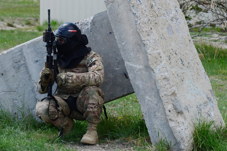 An Airman with the 841st Missile Security Forces Squadron takes cover during a training scenario June 24, 2018, at Fort Harrison, Mont.
