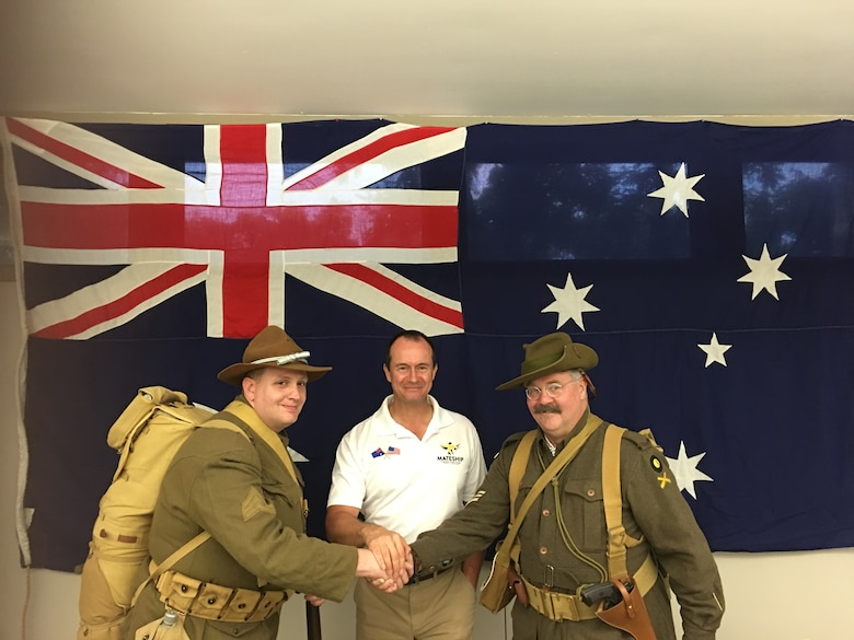 "Australians celebrating ""'100 years of Mateship""' between Australia and the United States at Wright-Patterson Air Force Base on June 20 are (left to right): Jeremy Bowles; Wing Commander Andrew State of the Royal Australian Air Force; and Joseph Otmar. Bowles and Otmar are dressed in period uniforms like those worn during the Battle of Hamel on July 4, 1918. (U.S. Air Force photo/Glenn DeBerry)"