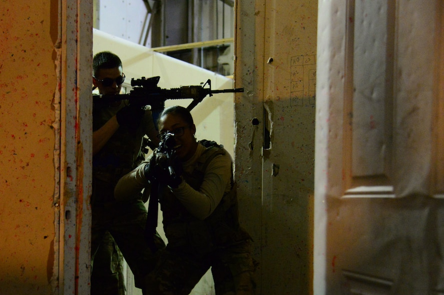 Airmen with the 841st Missile Security Forces Squadron run through protocol to enter a room during training June 14, 2018, at Malmstrom Air Force Base, Mont.