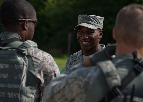 Chief Master Sgt. of the Air Force Kaleth O. Wright complements the Airmen of the 633rd Security Forces Squadron for their performance during his visit to Joint Base Langley-Eustis, Virginia, June 29, 2018. Wright toured JBLE for two days seeing the day-to-day operations of the different wings and units here. (U.S. Air Force photo by Airman 1st Class Anthony Nin-Leclerec)