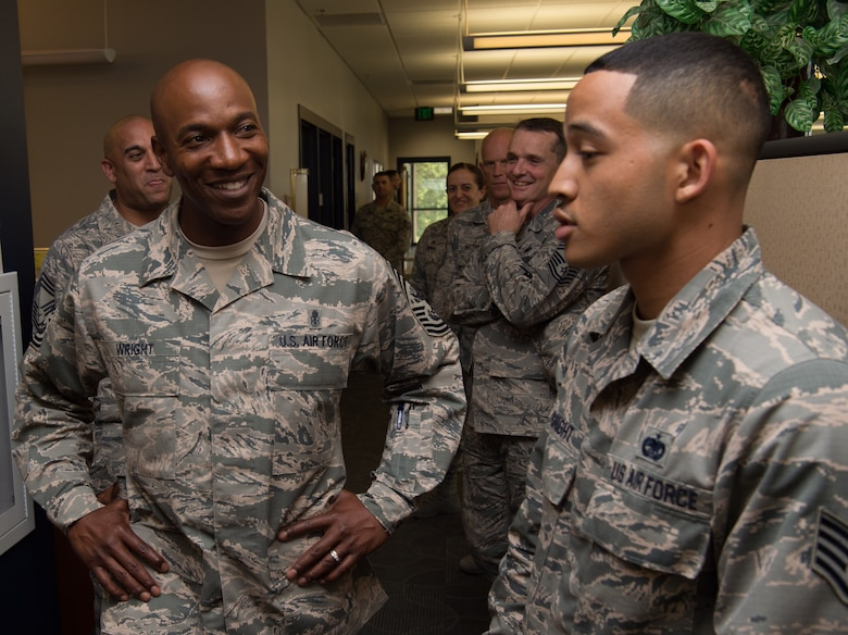 Staff Sgt. Jordan Basnight, 441st Vehicle Support Chain Operations Squadron NCO in charge, gives a brief on his section to Chief Master Sgt. of the Air Force Kaleth O. Wright at Joint Base Langley-Eustis, Va. June 28, 2018. Basnight provided an overview of 441th VSCOS support and their role as the vehicle enterprise manager here. (U.S. Air Force photo by Senior Airman Tristan Biese)