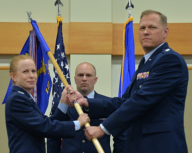 Lt. Col. Stephen Meister, right, accepts command of the 12th Missile Squadron from Col. Anita Feugate Opperman, 341st Operations Group commander during a change of command ceremony July 2, 2018, at the Grizzly Bend on Malmstrom AFB, Mont.