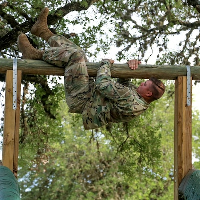 Spc. Bryce Falgiani, a San Antonio native, completed a rigorous obstacle course as one of the events during the Best Warrior Competition. He is advancing to the final level in October where he will compete against Soldiers from all over the world.