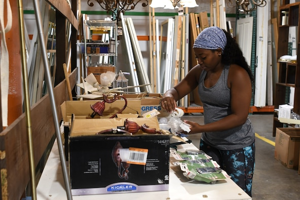 U.S. Air Force Senior Airman Donaisha Campbell, 81st Surgical Operations Squadron women's health technician, sorts lighting equipment at the Habitat for Humanity Restore in Gulfport, Mississippi, June 28, 2018. This was a week-long volunteer event where Airmen helped restock, sort, clean, price and help customers at the store. In addition to the volunteer work Airmen do on their own in the community, Keesler Air Force Base organizes wing-wide volunteer events once a quarter to show their support to the surrounding community. (U.S. Air Force photo by Airman 1st Class Suzie Plotnikov)