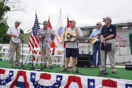 The Deep Water Boys perform to celebrate the 50th Anniversary of J. Percy Priest Dam ahead of the official ceremony for the 50th Anniversary of J. Percy Priest Dam and Reservoir at the dam in Nashville, Tenn., June 29, 2018.  The members of the Deep Water Boys are made up of current and retired Corps of Engineers employees. (USACE Photo by Mark Rankin)