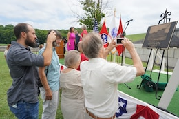 People take pictures of the commemorative plaque unveiled during the 50th Anniversary of J. Percy Priest Dam and Reservoir at the dam in Nashville, Tenn., June 29, 2018. (USACE Photo by Mark Rankin)