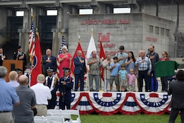 The family of Col. Jesse Fishback leads the Pledge of Allegiance during the 50th Anniversary of J. Percy Priest Dam and Reservoir at the dam in Nashville, Tenn., June 29, 2018. The late colonel served as the district engineer of the U.S. Army Corps of Engineers Nashville District when officials dedicated the project June 29, 1968. (USACE Photo by Lee Roberts)