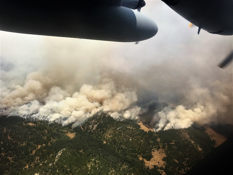 The view of the Spring Creek fire from an Air Force Reserve Modular Airborne Fire Fighting System-equipped C-130 Hercules aircraft in Colorado, July 2, 2018.