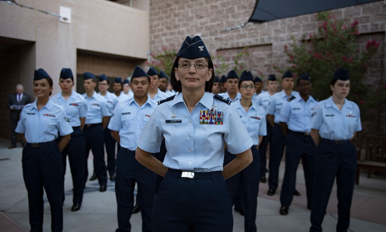 Col. Suzie Dietz, 99th Inpatient Operations Squadron commander, stands in front of a flight of Airmen during a change of command ceremony at Nellis Air Force Base, Nevada, June 29, 2018. The 99th IPTS is responsible for delivering safe care for Department of Defense patients. (U.S. Air Force photo by Airman 1st Class Andrew D. Sarver)