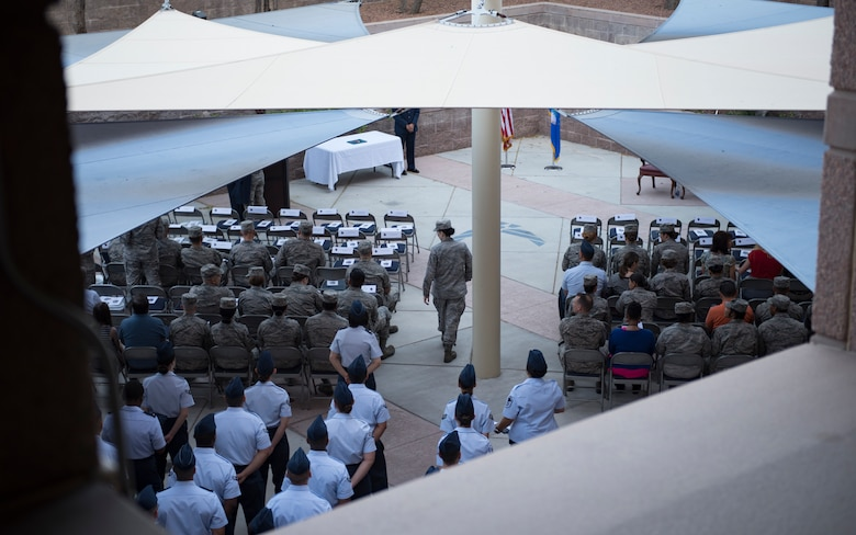 Airmen gather for the 99th Medical Group change of command ceremony at Nellis Air Force Base, Nevada, June 29, 2018. The 99th MDG provides medical care to Department of Defense beneficiaries to ensure maximum wartime readiness and combat capability. (U.S. Air Force photo by Airman 1st Class Andrew D. Sarver)