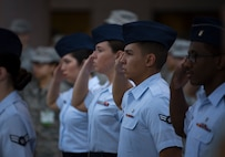 Airmen assigned to the 99th Medical Group render a salute during the playing of the National Anthem at Nellis Air Force Base, Nevada, June 29, 2018. The Airmen were part of the initial flight of Airmen during a change of command ceremony for the 99th MDG. (U.S. Air Force photo by Airman 1st Class Andrew D. Sarver)