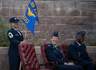 Chief Master Sgt. Nicole Owens, 99th Medical Group superintendent, Col. Virginia Garner, 99th MDG outgoing commander, and Col. Alfred Flowers Jr., 99th MDG incoming commander, laugh during a change of command ceremony at Nellis Air Force Base, Nevada, June 29, 2018. Change of command ceremonies are a military tradition and dates back to the time of Frederick the Great of Prussia. (U.S. Air Force photo by Airman 1st Class Andrew D. Sarver)