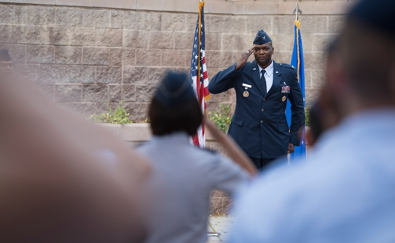 Col. Alfred Flowers Jr., 99th Medical Group commander, receives his first salute from Col. Suzie Dietz, 99th Inpatient Operations Squadron commander, during a change of command ceremony at Nellis Air Force Base, Nevada, June 29, 2018. The 99th MDG ensures medical care for more than 10,000 active duty personnel. (U.S. Air Force photo by Airman 1st Class Andrew D. Sarver)