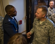 Col. Alfred Flowers Jr., 99th Medical Group commander, greets Col. Mathew Boschert, 99th Mission Support Group commander, during a change of command ceremony at Nellis Air Force Base, Nevada, June 29, 2018. The 99th MDG provides medical care to Department of Defense beneficiaries to ensure maximum wartime readiness and combat capability. (U.S. Air Force photo by Airman 1st Class Andrew D. Sarver)
