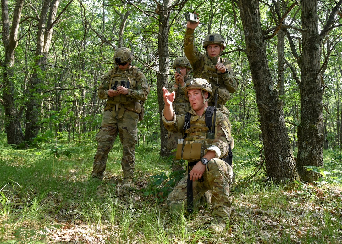 A team of Explosive Ordnance Disposal technicians work their way through a land navigation course June 25, 2018, at Fort McCoy, Wisconsin. The course allowed Airmen to practice their skills in map reading, compass use, and pace counting.