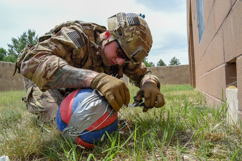 Senior Airman Alec Camp, an Explosive Ordnance Disposal technician with the 142nd Fighter Wing, Portland Air National Guard Base, Oregon, disrupts a possible explosive train June 22, 2018, during a training exercise on Fort McCoy, Wisconsin. The exercise, known as Audacious Warrior, provides EOD Airmen with required training over the course of two weeks.(U.S. Air National Guard photo by Airman Cameron Lewis)