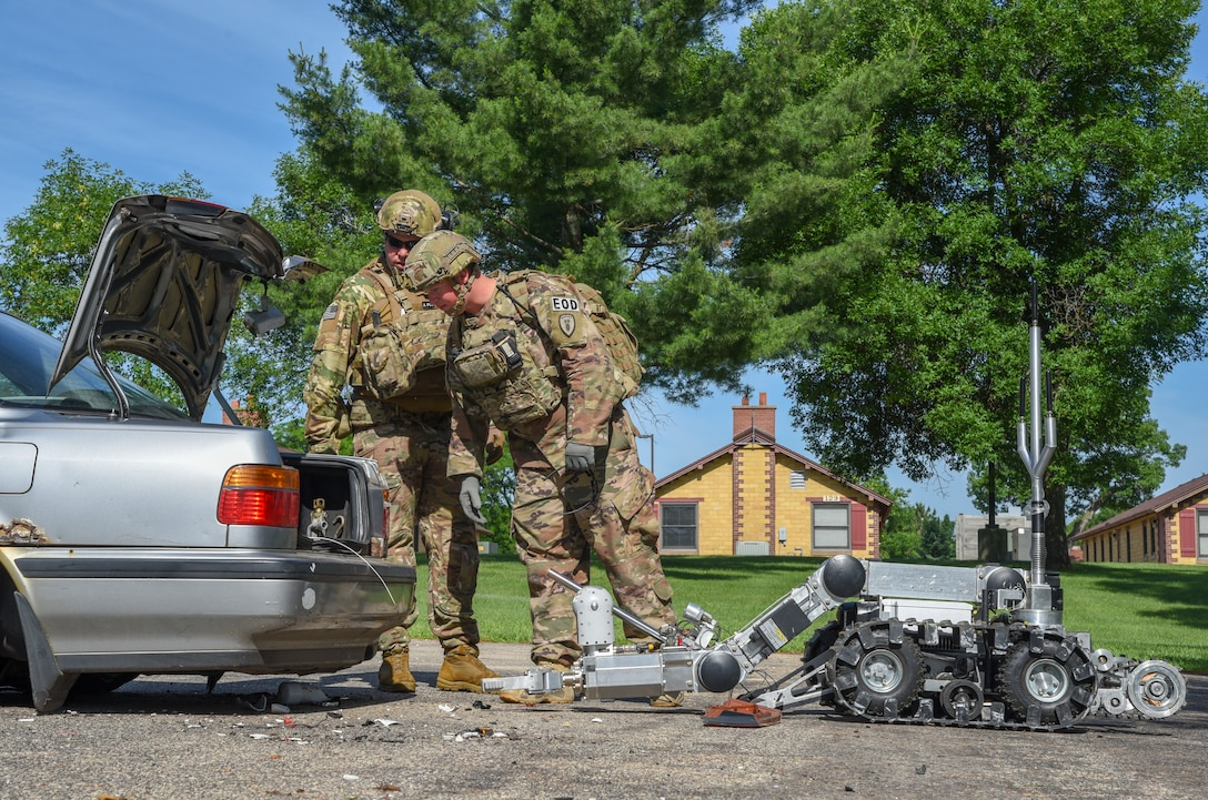 Master Sgt. Jason Ganner, the Explosive Ordnance Disposal resources NCO, for the 142nd Fighter Wing, Portland Air National Guard Base, Oregon, and Staff Sgt. Tyler Porter, an EOD technician with the 155th Air Refueling Wing, confirm the disruption of an explosive device and collect evidence June 23, 2018, at Volk Field Air National Guard Base, Wisconsin. Ganner and Porter are at Volk as part of the annual Audacious Warrior Exercise. (U.S. Air National Guard photo by Airman Cameron Lewis)