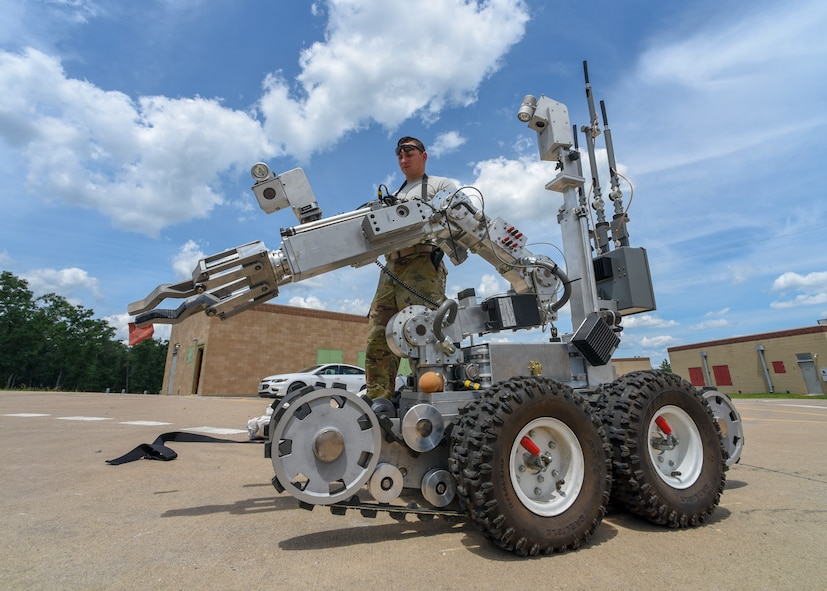 Senior Airman Kyle Doran, an Explosive Ordnance Disposal technician with the 104th Fighter Wing, Massachusetts Air National Guard, operates an F6 Robot during the Audacious Warrior Exercise June 23, 2018, at Fort McCoy, Wisconsin. The F6 was used to remotely check a suspicious item inside a building. (U.S. Air National Guard photo by Airman Cameron Lewis)