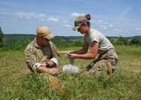 Airman 1st Class Casey Philpot, an Explosive Ordnance Disposal technician with the 115th Fighter Wing in Truax Field, Wisconsin applies a pressure bandage to Staff Sgt. Nash Bauer, an EOD technician with the 115th FW, June 25, 2018, during the Audacious Warriors Self Aid Buddy Care training refresher. SABC encompasses basic life support and limb-saving techniques to help wounded or injured personnel survive in medical emergencies.